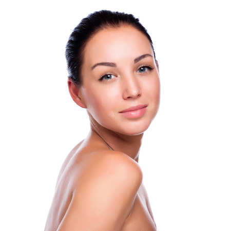 skin care products: Pretty face of beautiful smiling woman - posing at studio isolat Stock Photo