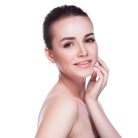 aging: Pretty face of beautiful smiling woman - posing at studio isolat Stock Photo
