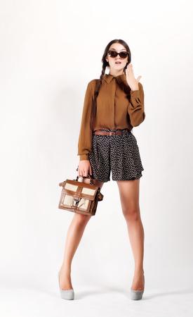 beauty full: Full Length Portrait of Trendy Hipster Girl.  Urban Fashion Concept.