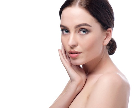 aging: Beautiful Young Woman Touching Her Face.Fresh Healthy Skin.Isolated on White. Stock Photo