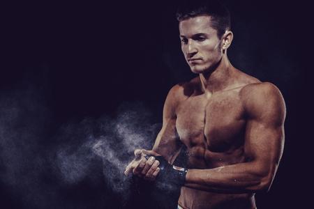 darck: MMA Fighter Preparing Bandages For Training. Darck background Stock Photo