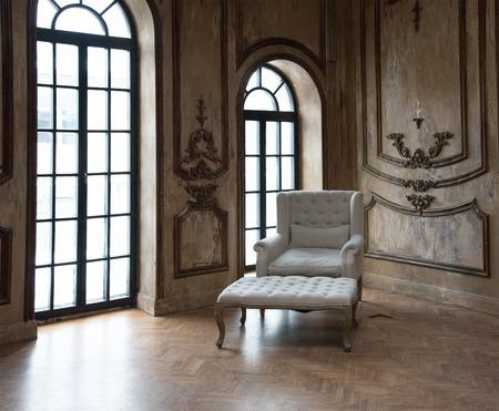 Old Retro Armchair against Window Foto de archivo