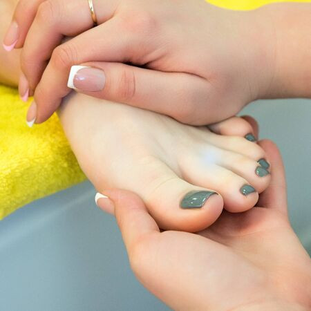 rapprochement: Pedicure and foot massage.Woman in a beauty salon for pedicure and foot massage. Stock Photo