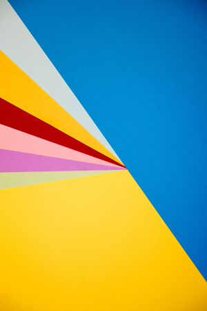 blue violet: Color papers geometry flat composition background with yellow orange red violet and blue tones. Stock Photo