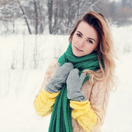 blond girl: Beautiful winter portrait of young woman in the winter snowy scenery.