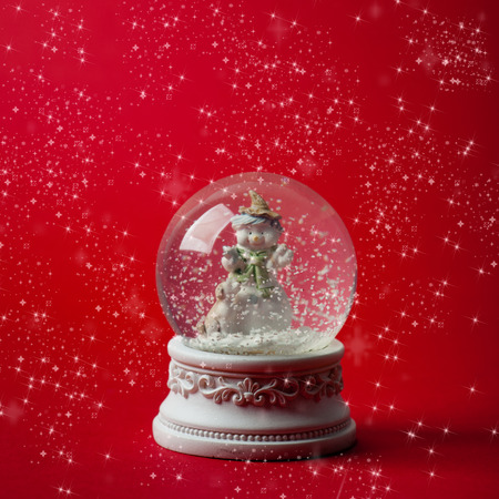 snow  snowy: Xmas snow ball over red snowy background