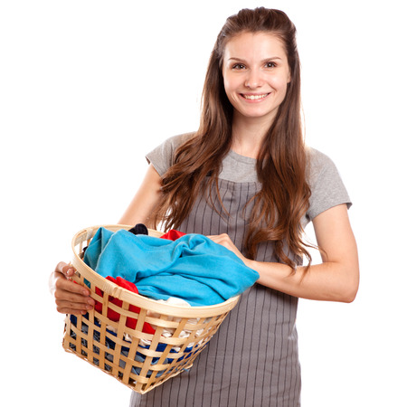 Happy Woman Carrying Laundry Basket Isolated on white Фото со стока