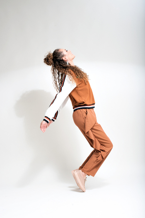 young and beautiful dancer posing on studio background.