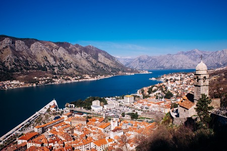 Kotor, Montenegro. Bay of Kotor bay is one of the most beautiful places on Adriatic Sea, it boasts the preserved Venetian fortress, old tiny villages, medieval towns and scenic mountains Stock Photo