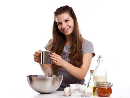Portrait of beautiful chef home cook at home with dessert cupcakes homemade sweets. Фото со стока - 115176778