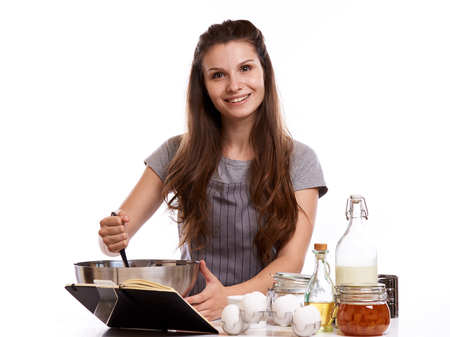 Portrait of beautiful chef home cook at home with dessert cupcakes homemade sweets.