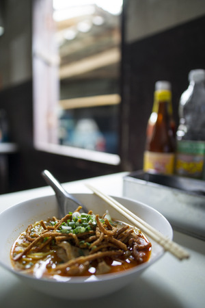 soi: Thai spicy food, Egg noodle in chicken curry or name in thai is khao soi kai Stock Photo