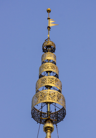 tiered: Gold plated tiered umbrella , a sign of royalty