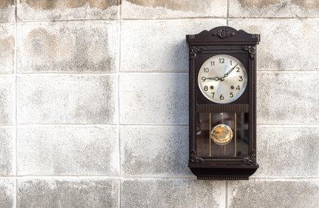pendulum: Antique wall clock with a pendulum Stock Photo