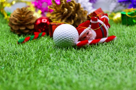 Golf ball and Santa with pine cones