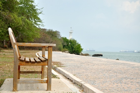 One of benches along the beach park walkway photo