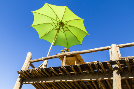 Terrace and umbrella blue sky background Stock Photo