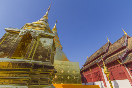 Old Church and golden pagoda at Phra Singh temple at the northern of Thailand, Chiangmai, Thailand Stock Photo