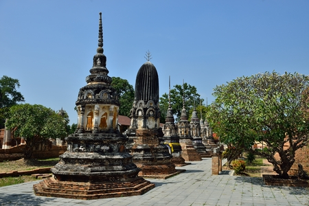 aukana buddha: The ancient pagoda with blue sky in Thailand
