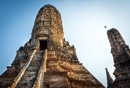 phra nakhon si ayutthaya: Ancient pagoda with bird and Brick wall in Old Thai Temple at Ayutthaya Historical Park (Public Place), Phra Nakhon Si Ayutthaya, Ayutthaya, Thailand Stock Photo