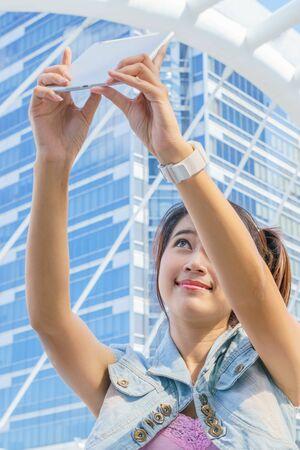 beautiful woman selfie in urban landscape photo