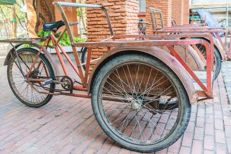 trishaw: red trishaw for transportation in parking