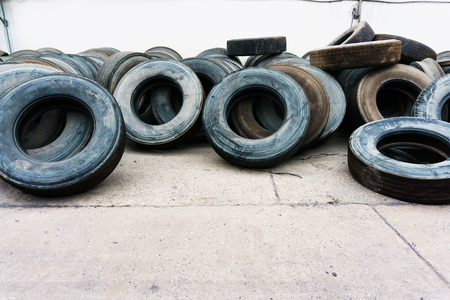 align: tires heap align on cement ground, used tires