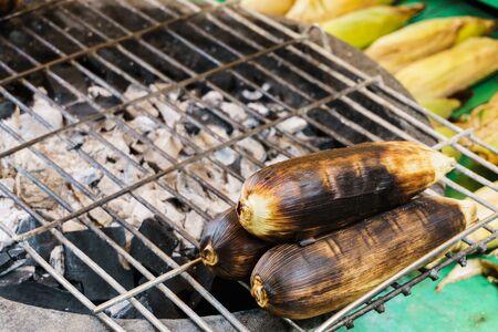 cinder: grilled corns on cinder stove, close up