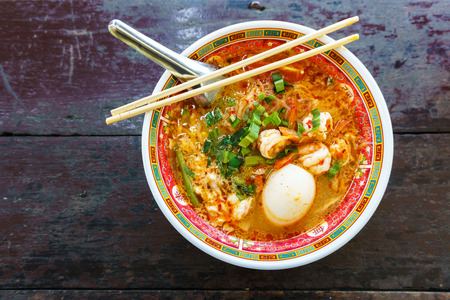 noodles soup: prawn noodles soup with egg in bowl chinese style on wood table