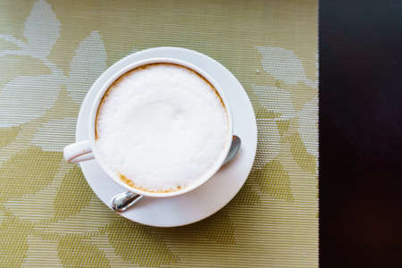 teaspoon: coffee cup and teaspoon on table, top view Stock Photo