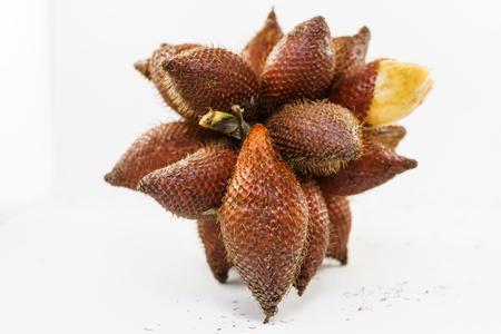 salak: clusters of fresh salacca on white background, Salak fruit Stock Photo