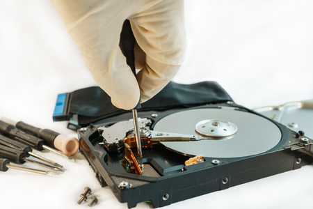 data recovery: screw hard disk drive to repair for recovery information  data storage
