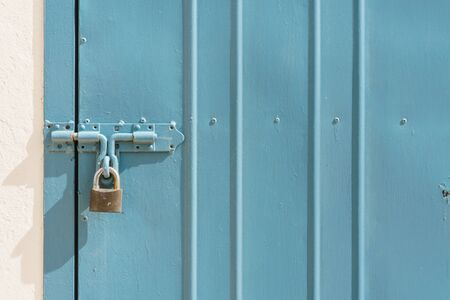 safety lock: blue metal door with padlock texture and background