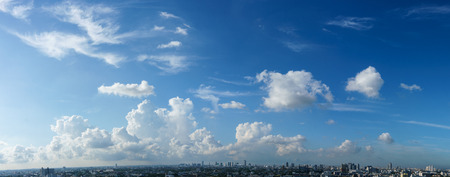 panorama: Blue sky and white cloud over the cityscape cloudy sky Panorama Stock Photo