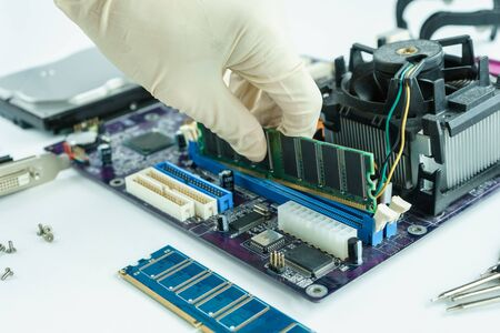 main board: remove random access memory from socket on PC main board
