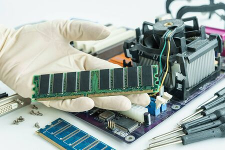 repair computer: random access memory on repairman hand to check and repair Stock Photo