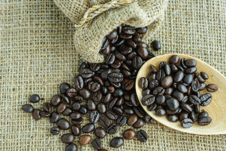 scatter: heap of fresh coffee bean scatter from a jute bag