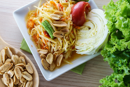 green papaya salad: Thai green papaya salad called Som Tum serve with vegetable, Thai food Stock Photo