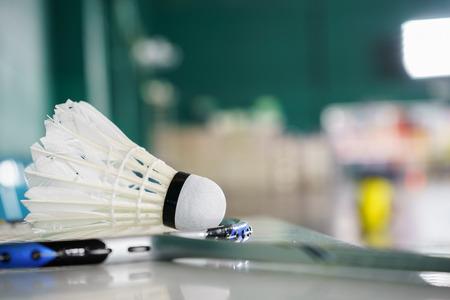 badminton: Shuttlecock for badminton sport games on racket, badminton court