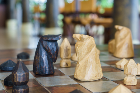 chess board: Wooden chess on chess board ready to battle, Thai Chess Stock Photo