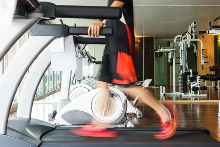 treadmill: Man exercise on treadmill for healthy in fitness gym