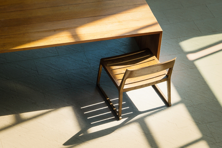 baseboard: Light and shadow on wooden chair and table in top view side, Chair space for background Stock Photo