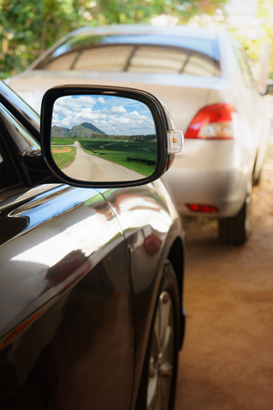 rearview: Green nature with road view in Rearview mirror, Landscape in car mirror