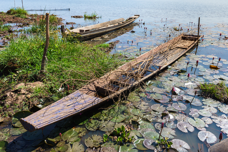 old boat: Old boat for fishery beside lakeside, Thailand countryside Stock Photo