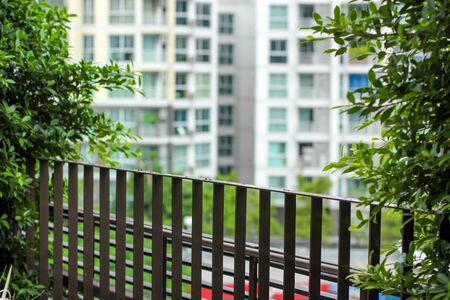 baranda para balcon: background buildings seen from metal balcony Editorial