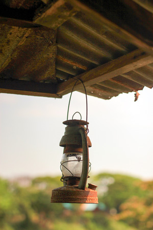 Rusty Lit Old Lantern Hanging In An Shed Stock Photo