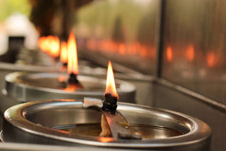 Burning candles in a temple Stock Photo
