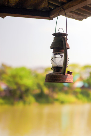 Rusty Lit Old Lantern Hanging In An Shed Stock Photo Picture