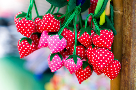 Colorful rubber band hair made from fabric red color and white dot pattern. Design like Strawberry Fruit.