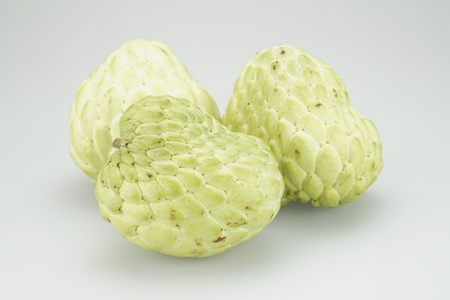 sweetsop: Group custard apple, sugar apple, sweetsop or annona squamosa on a white background.